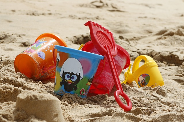toys kits on a sandy beach - how do you clean toys like these
